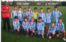 The U11 League Cup Final Squad with coach, Azeez